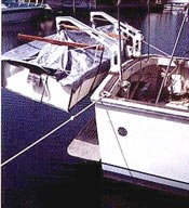 porta-bote dinghy on sailboat davit